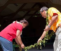 Mayor Billy Kenoi assists with the ceremonial untying of the maile lei at the grand re-opening of Keokea Beach Park. (PHOTOS BY ANNA PACHECO | SPECIAL TO NHN)