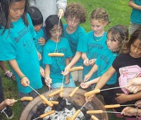 Parker summer camp students cook hotdogs over a grill during their science and hawaiian summer camp. (PHOTO COURTESY OF PARKER FOR NHN)