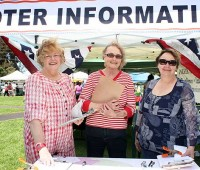 From left, Patti Cook, Elaine Warner, and Ruth Sturges help with the voter registration booth at the Waimea Town Market on July 14. (PHOTO BY LISA MARIE DAHM FOR NHN)